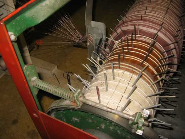 "close up of warping guide, puts 2"" width of warp between pegs on warp beam"