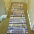 18 ft hallway rug of various cotton cloth made on Deen Loom